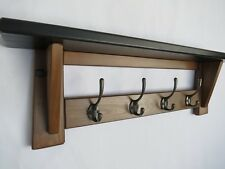 Wooden hat and coat  rack with shelf ( 4 hooks. Black and brown)