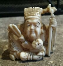 A 19th Century Carved Japanese Netsuke of an Immortal. Signed.