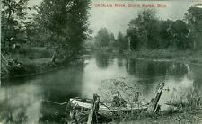 South Haven, MI Man Waiting in Rowboat on Black River 1908