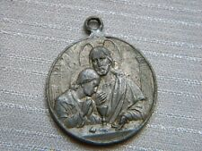 ANTIQUE METAL MEDAL FIRST COMMUNION