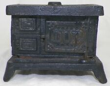 VINTAGE CAST IRON DOT STOVE BANK MINIATURE COOK WITH CASH TOY DOLLHOUSE OVEN