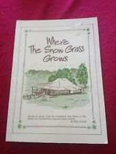 NEIL HULM SIGNED BOOK. WHERE THE SNOW GRASS GROWS