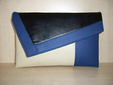 OVER SIZED ROYAL BLUE, CREAM & BLACK asymmetrical faux leather clutch bag.