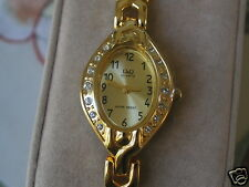 New Q&Q by Citizen Gold Tone Lady Dress Watch w/Black Number Golden Dial