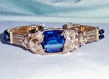33 ct Natural Cushion Blue Sapphire gemstone, 14kt yellow gold Bangle Bracelet