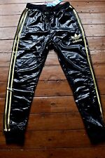 Adidas Chile 62 Cuffed Track Pants. Brand New. Shiny Black/Gold. Small