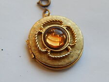 VTG  ROUND . GOLD PLATED TEXTURED , ORNATE . AMBER  GLASS LOCKET PENDANT