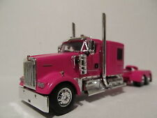 DCP 1/64 SCALE W900 KENWORTH FLAT TOP PINK, LONG WHEEL BASE , WTI FENDERS