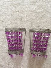 Purple beaded curtain rod and valance holder