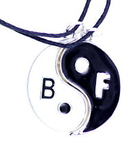 A pair of two parts black and white magnet yin yang sign necklaces