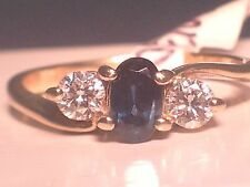 Ladies Natural Diamond and Sapphire ring in 14k Yellow Gold.