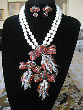 """Heidi Daus """"Reel McKoi"""" Crystal Accented Double Strand  Necklace and earrings"""