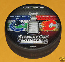 VANCOUVER CANUCKS vs CALGARY FLAMES 2015 Playoffs Round 1 NHL DUELING LOGO PUCK