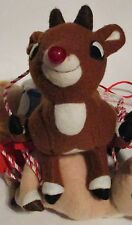 Hanging Rudolph Swing Decoration   three plush toys hanging on a wooden swing