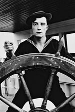BUSTER KEATON B&W HOLDING WHEEL OF BOAT 24X36 POSTER