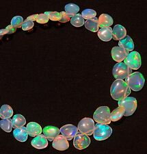 Super Flashing & Playing Fire Ethiopian Opal 6-8MM Heart Briolettes 34Cts. 7""