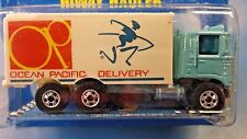 1990 Hot Wheels Ocean Pacific Delivery Hiway Hauler #24 Blue Card w/ Brown Back