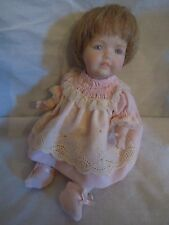 """Porcelain reproduction baby doll; 7"""" tall; in pink signed J. Merkel 1990 cp-688"""