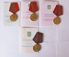 SOVIET 4 MEDALLAS CON PAPELES MEDALLAS CONMEMORATIVAS PERTENECE A UNA PERSONA