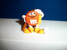 M&M's CAVEMAN Orange HEAD SCRATCHER EGG Figurine M&M French Pocket Surprise M&Ms