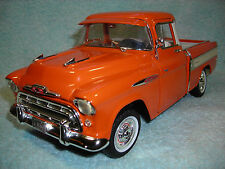 1/18 1957 CHEVY C-10 PICK UP IN ORANGEWHITE  BY ERTL AMERICAN MUSCLE NO BOX.