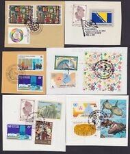 UNITED NATIONS 50 stamps on 15 envelope cutouts @K151