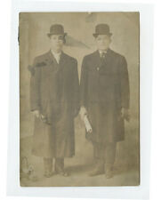 CAB PHOTO OF 2 YOUNG MEN IN DERBY HATS   LONG COATS W/ PROPS