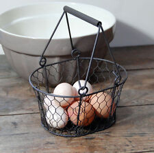 Small traditional dark brown vintage style metal wire egg basket.