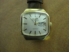 #210 mans gold plate day/date 1979 DAY/DATE BULOVA watch