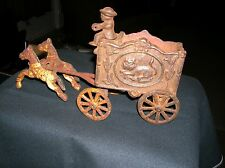 VINTAGE CAST IRON TOY HORSE DRAWN LION CIRCUS WAGON WITH DRIVER MAN OLD PAINT