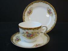 NORITAKE FLORAL SPRAY AND GILT TRIO CUP SAUCER AND SIDE PLATE