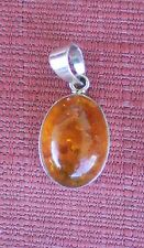 Elegant Oval Amber Pendant from Thailand w/ 925 Sterling Silver Setting