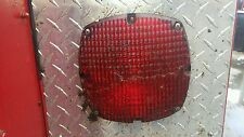 Round red tail lights for a bus or fire truck