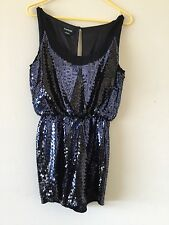 Bebe ladies size 4 ADORABLE SEQUIN ROMPER