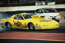 573000 A Canary yellow Firebird Spins Its Tires To Heat Them Up A4 Photo Print