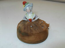 VINTAGE PIN CUSHION WITH A CHINA DOLL  CUSHION FEELS LIKE IT WAS VELVET