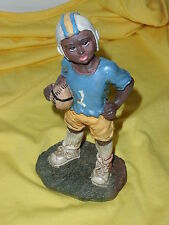 Black American Figurine Boy Holding A Football