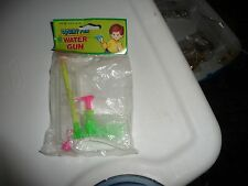 vtg SEALED in original package SQUIRT FUN water pistal 5'' long x 3 3/4'' tall