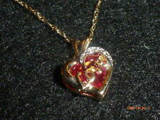 "10K YELLOW GOLD RUBY HEART-SHAPED ""LOVE' PENDANT AND 10K  YELLOW GOLD CHAIN"