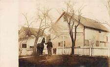 RPPC MAN IN UNIFORM WITH HORSE HOUSES FARM REAL PHOTO POSTCARD (c.1910)