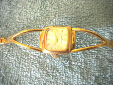 Ann Klein 10/6472-3  7121E  Gold Toned Watch.  Free Watch Included!!