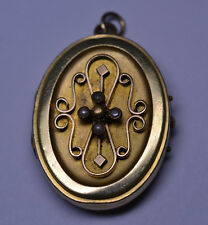 VINTAGE 1 3/8 IN. OVAL LOCKET WITH SEED PEARLS & RAISED SCROLL DESIGN AS IS