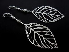 A PAIR OF  BIG  DANGLY SILVER COLOUR  LEAF LEVERBACK HOOK  EARRINGS. NEW.
