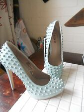 pair of ladies high heel shoes with spikes on size 6 5 inch heel