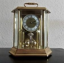 HOWARD MILLER  BRASS MANTLE CLOCK WITH ROTATING PENDULUM -MADE IN GERMANY
