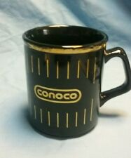 Black Conoco oil coffee cup with gold leaf edging