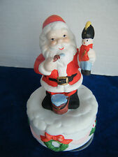 Musical Ceramic Santa Claus holding toy soldier, rotates on base when wound up!