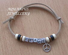 PEACE FRIENDSHIP BRACELET WOODEN BEADS/SMALLPEACE CHARM ON A BEIGE SUEDE CORD