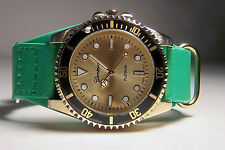 BEAUTIFUL GENEVA PLATINUM WRIST GUARD LADIES WATCH WITH GREEN STRAP