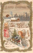 ANGEL PUSH-PULL SLED WITH TREE & PRESENTS~A MERRY CHRISTMAS POSTCARD c1910s